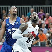 29 July 2012: Boris Diaw of France vies for the rebound with USA LeBron James during the 98-71 Team USA victory over Team France, during the men's basketball preliminary, at the Basketball Arena, in London, Great Britain.