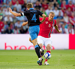 26.05.2012, Ullevaal Stadion, Oslo, NOR, UEFA EURO 2012, Testspiel, Norwegen vs England, im Bild England's captain Steven Gerrard (Liverpool) in action against Norway's captain Brede Hangeland (Fulham) during the Preparation Game for the UEFA Euro 2012 betweeen Norway and England at the Ullevaal Stadium, Oslo, Norway on 2012/05/26. EXPA Pictures © 2012, PhotoCredit: EXPA/ Propagandaphoto/ Vegard Grott..***** ATTENTION - OUT OF ENG, GBR, UK *****
