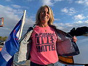 Wearing a T-shirt she's had since the 2016 presidential race, Trump supporter Donna Tourville joins a rally to show her ongoing support for the President.