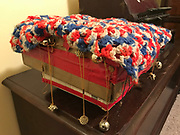 Decorated hand made cardboard box with red white and blue knitted top –adorned with red tape and whole thing Spins- and has bears and beads-8x8in<br /> <br /> THIS IS PART OF OUR COLLECTION OF MARGARET'S GROCERY AND REV. H.D. DENNIS - ART WORKS in Mississippi Folk Art Foundations Collection <br /> <br /> Ms. Altman is the Founder and Director of the Mississippi Folk Art Foundation a non profit, that is dedicated to preserving Margaret's Grocery. A visionary outdoor folk environment in Vicksburg Mississippi.<br />  to see some of the collection documented by William Arnett in his book Souls Grown Deep volume 2 please see see link below.<br /> <br /> http://www.soulsgrowndeep.org/artist/rev-harmon-d-dennis<br /> <br /> <br /> https://www.gofundme.com/SaveMargaretsGrocery?lang=en-US