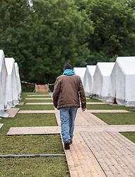 24.05.2015, Polizeidirektion, Salzburg, AUT, Zeltstadt fuer Fluechtlinge in Salzburg, im Bild ein Flüchtling spaziert zu seinem Zelt // a refugee in the tent city at the sports ground of the Police Directorate, Salzburg, Austria on 2015/05/24. EXPA Pictures © 2015, PhotoCredit: EXPA/ JFK