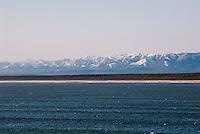 Russia, Sakhalin, Sea of Okhotsk. Sakhalin coastline with snow covered mountains.