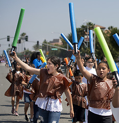 May 4, 2019 - Fontana, California, U.S. - Date Elementary students show off their Star Wars saber spirit for the judges at the 2019 Fontana Days Parade on Saturday, May 4, 2019. Most of the parade route was lined with cheering onlookers. (Credit Image: © Cindy Yamanaka/SCNG via ZUMA Wire)