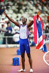 File photo dated 02-08-1992 of Linford Christie celebrates in front of the crowd after his 100m victory in Barcelona.