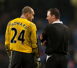 MANCHESTER, ENGLAND - Monday, February 25, 2008: Everton's goalkeeper Tim Howard and referee Rob Styles during the Premiership match against Manchester City at the City of Manchester Stadium. (Photo by David Rawcliffe/Propaganda)