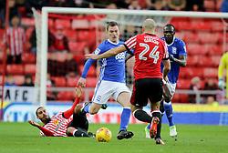 Birmingham City's Craig Gardner leaves Sunderland's James Vaughan on the deck as Sunderland's Darron Gibson closes in