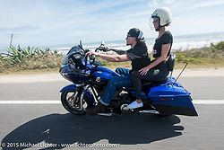 Amy and Jacob Cutler of Spencer MA on their Harley-Davidson Road Glide riding north on A1A to Flagler Beach during Daytona Beach Bike Week  2015. FL, USA. Friday, March 13, 2015.  Photography ©2015 Michael Lichter.