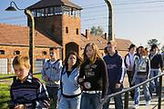 """Turysci przy wejsciu - Bramie Smierci, Auschwitz II-Birkenau<br /> Tourists at the entrance - """"Death Gate"""" in Auschwitz II-Birkenau, Poland"""
