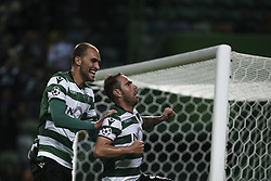 November 22, 2017 - Lisbon, Portugal - Sporting's midfielder Bruno Cesar celebrates with Sporting's forward Bas Dost after scores his goal during the UEFA Champions League group D match between Sporting CP and Olympiacos FC at Alvalade Stadium on November 22, 2017 in Lisboa, Portugal. (Filipe Amorim / Nurphoto) (Credit Image: © Filipe Amorim/NurPhoto via ZUMA Press)