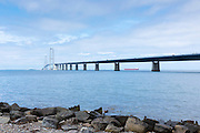 The Great Belt Bridge suspension bridge over Storebaelt joins Funen to Zealand view from Halskov rocks, Denmark