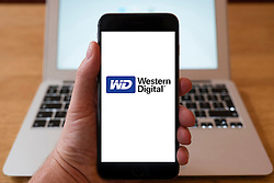 Using iPhone smartphone to display logo of Western Digital computer data storage company