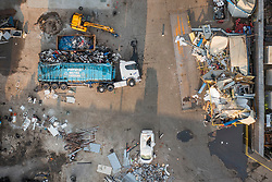 © Licensed to London News Pictures. 30/04/2021. Iver, UK. A truck lies on its side and damage to buildings can be seen at Paynes Metal Recycling plant near Iver in Buckinghamshire after, it was reported yesterday, that a digger driver went on a destructive rampage with a bulldozer causing £700,000 worth of damage.  Local reports say that a 44-year-old man appeared at Reading magistrates' court yesterday charged with various offences in connection with the incident.  Photo credit: Peter Macdiarmid/LNP