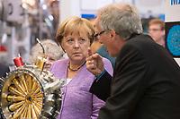 """19 SEP 2012, HAMBURG/GERMANY:<br /> Angela Merkel (L), Bundeskanzlerin, und Helmut Dosch (R), Vorsitzender DESY-Direktorium, besichtigen die PETRA III Experimentierhalle, Max von Laue-Fest """"Vorstoß in den Nanokosmos - Von Max Laue zu PETRA III"""" mit Taufakt der PETRA III-Experimentierhalle """"Max von Laue"""", mit Deutsches-Elektronen-Synchrotron, DESY<br /> IMAGE: 20120919-01-049"""