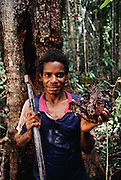A man from Sawa Village on the Pomats River in the Asmat, a large, steamy hot tidal swamp, shows a clump of a bee's nest containing edible larvae and honey, a sweet find in the sweaty swamp. Irian Jaya, Indonesia. Image from the book project Man Eating Bugs: The Art and Science of Eating Insects.