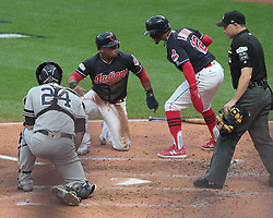 October 6, 2017 - Cleveland, OH, USA - The Cleveland Indians' Jose Ramirez, middle, is greeted by Francisco Lindor at the plate after scoring on a hit by Carlos Santana in the first inning against the New York Yankees during Game 2 of the American League Division Series, Friday, Oct. 6, 2017, at Progressive Field in Cleveland. (Credit Image: © Mike Cardew/TNS via ZUMA Wire)