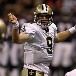 August 21, 2010; New Orleans, LA, USA; New Orleans Saints quarterback Drew Brees (9) signals an audible at the line during the first quarter of a preseason game against the Houston Texans at the Louisiana Superdome. Mandatory Credit: Derick E. Hingle
