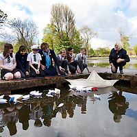 IN PURSUIT OF THE QUESTION MARK.THE WORK OF GEORGE WYLLIE INSPIRES A NEW GENERATION ..Picture shows : Fiona Hylsop, Cabinet Secretary for Culture and External Affairs with local school children from the nearby Riverside Primary School and St Saviours  ( School kids  l-r  - Elise Caldwell, Zoya Salah, John Cotlet of Riverside  and Reegan MacLeod, Josephine Barns and Charley Brown of St Saviours ) who are involved in the Friends of George Wyllie project release paper boats into a pond in Elder Park, Govan, Glasgow, mirroring plans for the wider project, as part of the year-long Whysman Festival. (www.whysman.co.uk) Also picture is George Wyllie's daughter, Louise...Picture Drew Farrell.Tel : 07721-735041..The BIG Little Paper Boat Project..Schools in the towns on all sides of the Clyde, will be invited to participate in this project, with the potential involvement of thousands of pupils at all stages and sectors of education across over 575 schools...Using new education resources inspired by Wyllie's art, and which focus on the outcomes and experiences of Curriculum for Excellence, pupils from Clydeside schools across all levels will have the opportunity to explore industrial change in their area and learn about skills once used there. ..Echoing the creation of Wyllies famous Paper Boat, the young people will create a flotilla of Origami Line paper boats. Activities inside The Big Little Paper Boat Shed will form a major part of a George Wyllie retrospective at The Mitchell, Glasgow from 3rd November 2012 - January 31 2013...He gave the world social sculptures to remember. The Straw Locomotive and The Paper Boat, to name but two. Now Glasgow-born artist George Wyllies creative legacy is set to inspire a new generation, thanks to a major award from the Year of Creative Scotland, 2012...Former Customs & Excise officer George Wyllie, now aged 90 and living in a care home for retired mariners in Greenock, always wanted to engage the wider world in his creative vision.