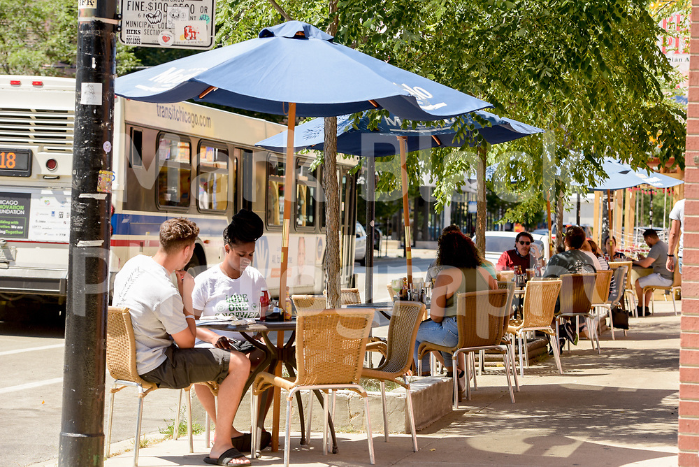 Outside dinning along 18th Street in the Pilsen neighborhood of Chicago on Wednesday, Aug. 19, 2020.  Photo by Mark Black