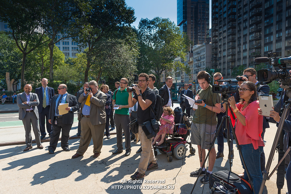 Presentation of Nissan Quest as NYC new taxi. Crowd of journalists with TV and photo gear