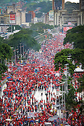 Crowds gather to listen to President of Venezuela, Hugo Chavez, during a  demonstration in favor of proposed constitutional reforms giving him more power in Caracas, Venezuela in November 2007.