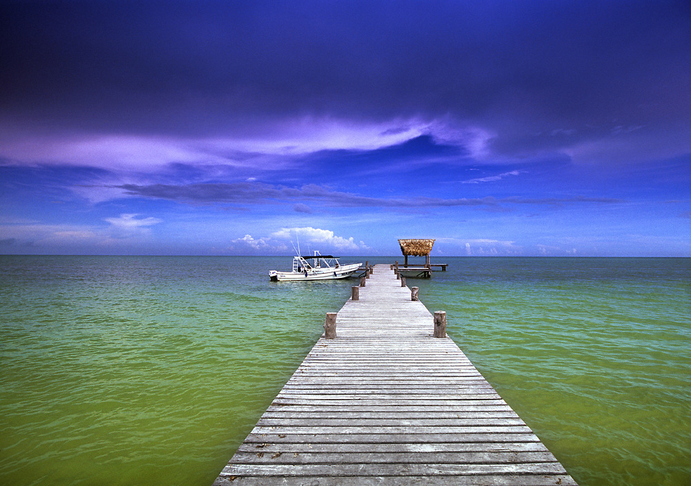 Fishing pier extends into the Gulf of Mexico on the Yucatan island of Holbox, Mexico.