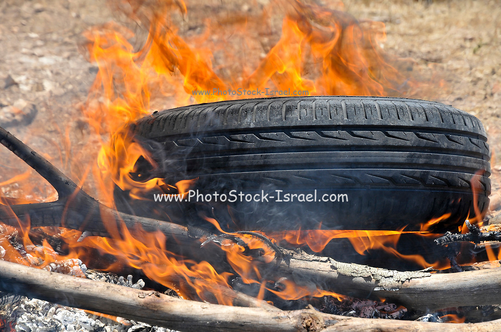 How to start a fire with old tires and branches. a set of 5 images