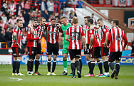 The team wait to start the second half during the English League One match at  Bramall Lane Stadium, Sheffield. Picture date: April 30th 2017. Pic credit should read: Simon Bellis/Sportimage
