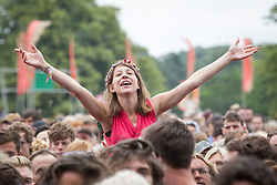 © Licensed to London News Pictures . 20/07/2013 . Suffolk , UK . A woman dances amongst the crowd as Jessie Ware performs on the Obelisk Stage . The Latitude music and culture festival in Henham Park , Southwold . Photo credit : Joel Goodman/LNP