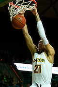 WACO, TX - JANUARY 3: Isaiah Austin #21 of the Baylor Bears dunks the ball against the Savannah State Tigers on January 3, 2014 at the Ferrell Center in Waco, Texas.  (Photo by Cooper Neill) *** Local Caption *** Isaiah Austin