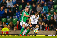 Northern Ireland defender Jonny Evans holds off Estonia forward Rauno Sappinen during the UEFA European 2020 Qualifier match between Northern Ireland and Estonia at National Football Stadium, Windsor Park, Northern Ireland on 21 March 2019.