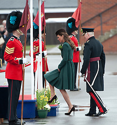 © London News Pictures. 17/03/2012. Aldershot, UK. The Duchess of Cambride CATHERINE (KATE) MIDDLETON stepping on to the dias after presenting traditional sprigs of shamrock to the 1st Battalion Irish Guards at Mons Barracks in Aldershot, Hampshire, UK,  on Saint Patrick's Day, March 17th, 2012.  Photo credit : Ben Cawthra/LNP.