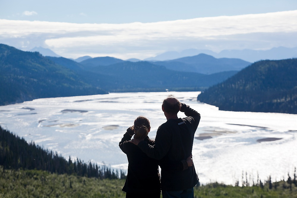 Liana and Parmenter Welty look out over the Chitina River river valley near Chitina, Alaska.