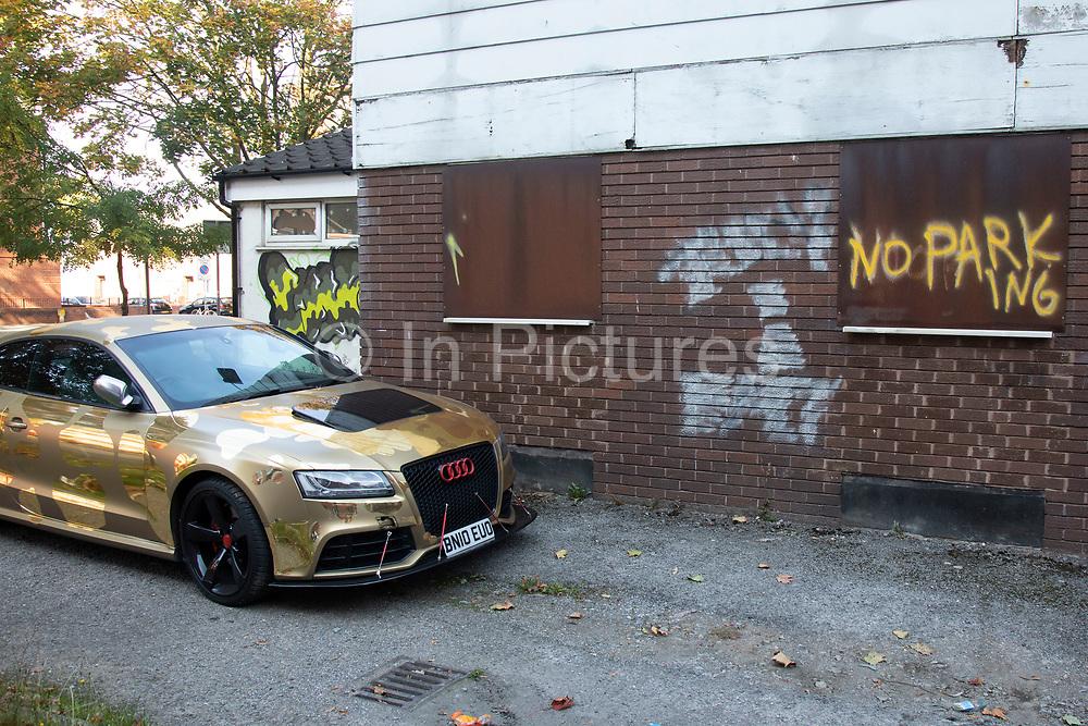 Gold leopard print Audi car in Manchester, England, United Kingdom.