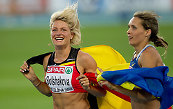 Third placed Belgium's Svetlana Bolshakova and winner Ukraine's Olha Saladuha celebrate after the women's triple jump final at the 2010 European Athletics Championships at the Olympic Stadium in Barcelona on July 31, 2010. (Photo by Vid Ponikvar / Sportida)