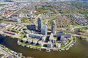 Nederland, Noord-Holland, Amsterdam, 09-04-2014; Omval met Rembrandt, Mondriaan en Breitner torens langs rivier de Amstel. Hoofdkantoor Philips in de Breitner toren en daarnaast Delta Lloyd, vormt het begin van de Zuid-as en achter de kantoortorens het Amstelstation, Aan het water stadsvilla's en woonboten. Linksonder kantoorgebouw Rivierstaete aan de President Kennedylaan ('de Apenrots') <br /> Rembrandt, Mondriaan and Breitner towers along the Amstel River. Headquarter Philips in the Breitner tower as well as Delta Lloyd<br /> The complex marks the beginning of the South axis ('city' - financial district). Behind the office towers the river Amstel with water villas and houseboats, in earlier times was this an industrial area<br /> luchtfoto (toeslag op standard tarieven);<br /> aerial photo (additional fee required);<br /> copyright foto/photo Siebe Swart