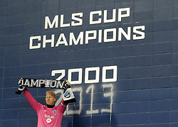 Dec 7, 2013; Kansas City, KS, USA; Sporting KC goalkeeper Jimmy Nielsen (1) celebrates after spray painting a wall in the stadium after the 2013 MLS Cup against Real Salt Lake at Sporting Park. Mandatory Credit: Denny Medley-USA TODAY Sports