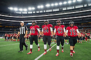 The Iraan High School football team take the field during the state championship game at AT&T Stadium in Arlington, Texas on December 15, 2016. (Cooper Neill for The New York Times)