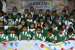 September 11, 2017 - Jakarta, Capital Region Of Jakarta, Indonesia - At-Taqwa kindergarten students put their hand prints with colorful watercolors on white cloths in Jakarta, September 11, 2017. The handprints they give as a form of solidarity, as well as raising donations for Myanmar children who experience violence in amid ethnic conflict in Rakhine state of Myanmar. The movement, initiated by the Indonesian Child Protection Institution, aims to get 10,000 handcuffs of Indonesian children, which will be handed over to UN representatives in Jakarta as an effort to ask the UN to act immediately to create peace in Myanmar. (Credit Image: © Aditya Irawan/NurPhoto via ZUMA Press)