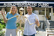 Align chiropractors advertising their services with help from a skeleton. Grand Old Day Festival. St Paul Minnesota MN USA