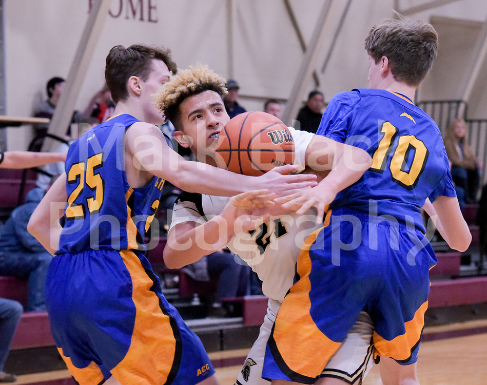 Aurora Central Catholic's Brenden O'Brien (25) and Danny Cwinski (10) struggle with Sycamore's Jason Hayes (21) for control of the ball during the Class 3A Wheaton Academy Regional on Monday, Feb. 25, 2019 in West Chicago.