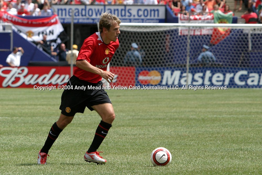 31 July 2004: Phil Neville during the second half. AC Milan of Italy's La Liga defeated Manchester United of the English Premier League 9-8 on penalties after the teams played to a 1-1 draw at Giants Stadium in the Meadowlands Complex in East Rutherford, NJ in a ChampionsWorld Series friendly match..