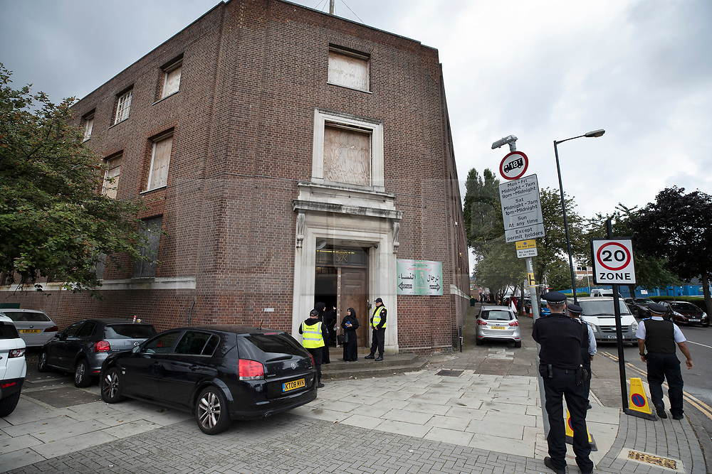 © Licensed to London News Pictures. 19/09/2018. London, UK. Police and private security guards stand at the entrance to The Hussaini Association Islamic Centre in Cricklewood, north London where a car hit two pedestrians last night. The incident , which took place in the early hours of this morning outside the centre, is being treated as a possible hate crime. Police are looking for a male driver who failed to stop at the scene, as well as two men and one woman in the car, all in their 20s. Photo credit: Peter Macdiarmid/LNP