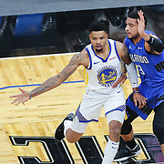 ORLANDO, FL - FEBRUARY 19:  Kent Bazemore #26 of the Golden State Warriors passes the ball in front of Chuma Okeke #3 of the Orlando Magic during the first half at Amway Center on February 19, 2021 in Orlando, Florida. NOTE TO USER: User expressly acknowledges and agrees that, by downloading and or using this photograph, User is consenting to the terms and conditions of the Getty Images License Agreement. (Photo by Alex Menendez/Getty Images)*** Local Caption *** Kent Bazemore; Chuma Okeke