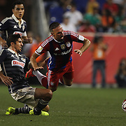 Franck Ribery, (right), Bayern Munich, is fouled by Jair Pereira, CD Chivas Guadalajara, during the FC Bayern Munich vs Chivas Guadalajara, friendly football match at Red Bull Arena, New Jersey, USA. 31st July 2014. Photo Tim Clayton