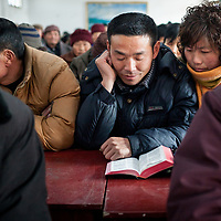 A couple reads the Bible together at a Three-Self Church.