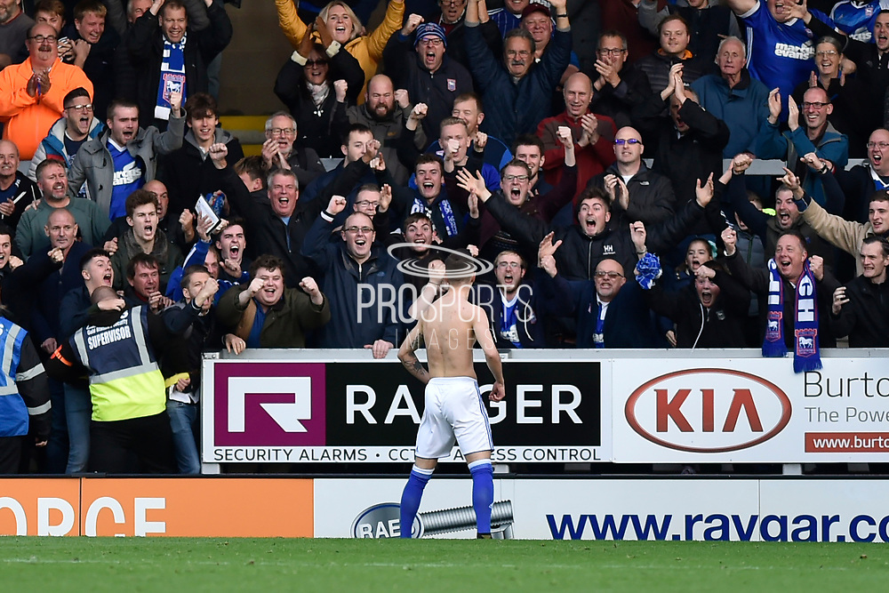 Ipswich Town midfielder Bersant Celina (11) celebrates scoring a goal, making the score 2-1, with Ipswich Town fans during the EFL Sky Bet Championship match between Burton Albion and Ipswich Town at the Pirelli Stadium, Burton upon Trent, England on 28 October 2017. Photo by Richard Holmes.
