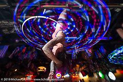 Dancing on the bar at the Dirty Dogg Saloon  on bike night to help kick off Arizona Bike Week 2014. USA. April 3, 2014.  Photography ©2014 Michael Lichter.