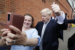 © Licensed to London News Pictures. 25/06/2019. Oxshott , UK. Conservative leadership candidate Boris Johnson campaigns in Oxshott, Surrey. Mr Johnson is campaigning in various locations in the south east of England today. Photo credit: Peter Macdiarmid/LNP