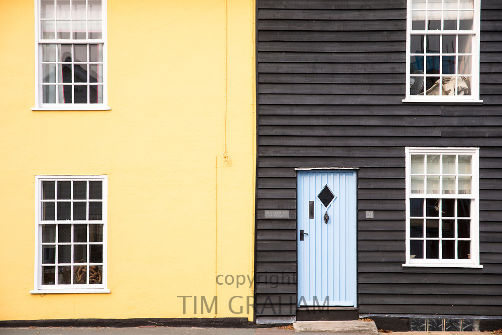 Traditional colourful homes with clapboard timber and sash windows in Woodbridge, Suffolk, England, UK