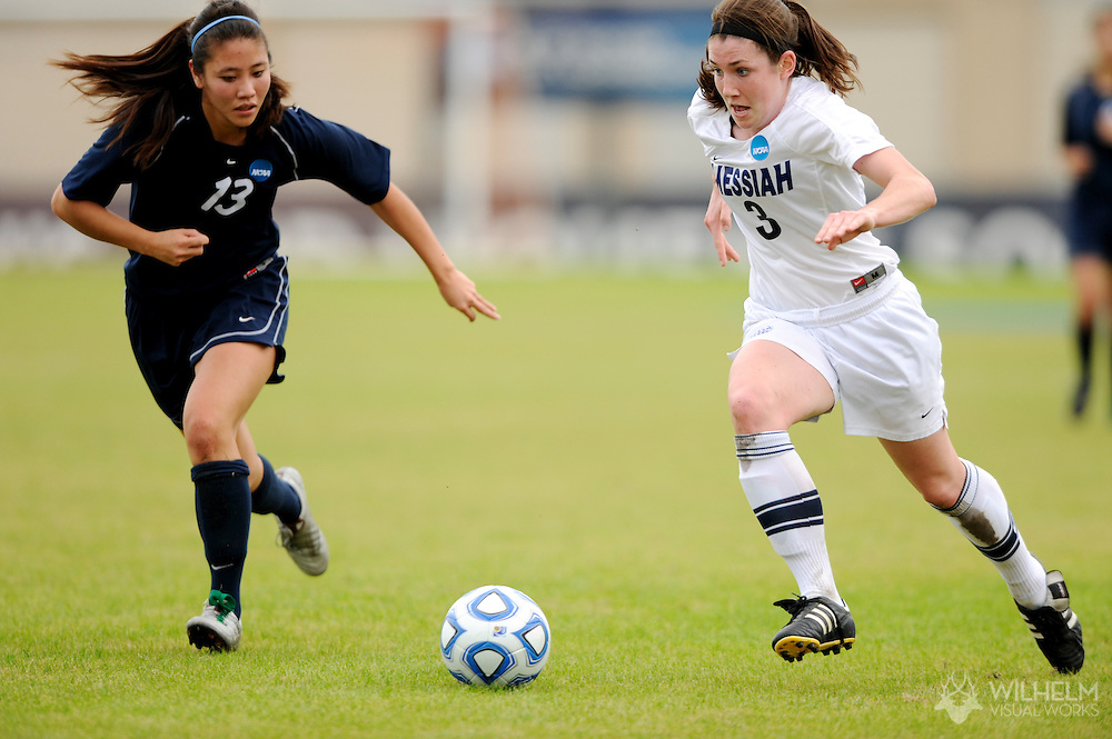 02 DEC 2011: Mackenzie Clapper (3) of Messiah College races past Esther Tan (13) of Wheaton College during the Division III Women's Soccer Championship held at Blossom Soccer Stadium hosted by Trinity University in San Antonio, TX. Messiah defeated Wheaton 3-1 to win the national title. © Brett Wilhelm